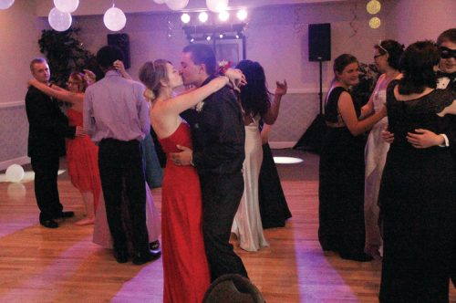 Marissa Bowman, 17, kisses her date, Johnathan Wenninger, 18, during a slow dance at the Riverwalk Clubhouse on May 5. Bowman, from Keenesburg, met Wenninger, of Brighton, in one of their online classes at Colorado Preparatory Academy.