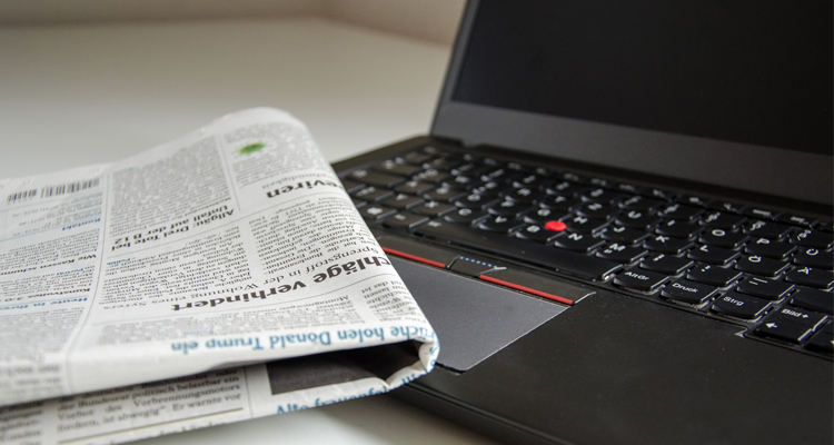 newspaper and laptop